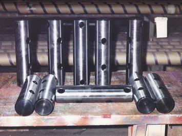 Special heat treat gudgeon shafts